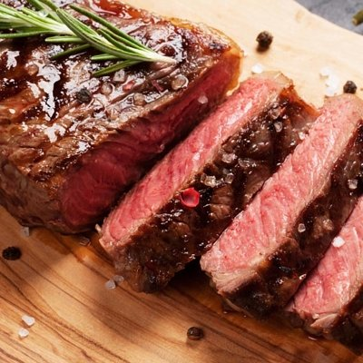 Steak meat processing in country butcher shop